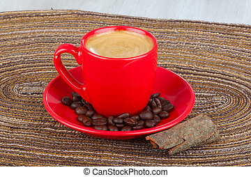 red cup coffee with coffee beans