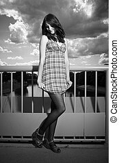 Girl posing on floodgate - Nice redhair lady posing in...