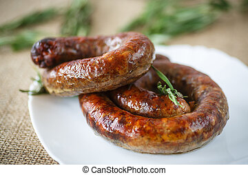 homemade bratwurst - home fried sausage with rosemary on a...