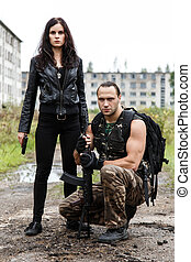 Guy with girl on a battlefield - War, conflict. Guy with...