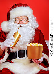 popular cinema - Close-up portrait of Santa Claus eating...