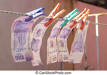 Money laundering - Mexican paper currency of 1000 pesos...