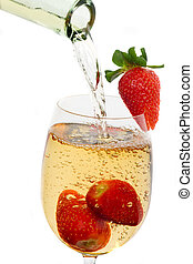 Fresh strawberry fruit in a glass of wine