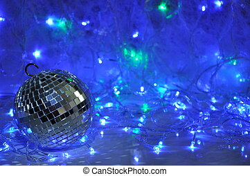 Disco christmas background with mirror ball and shining new...