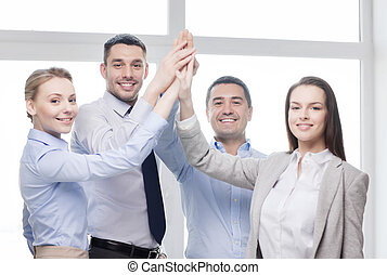 happy business team giving high five in office - success,...