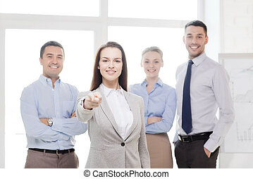 businesswoman in office pointing finger at you
