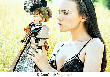 Summer Portrait3 - Scarlett holding a puppet in front of a...
