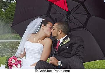 Married couple - Just married multi ethnic couple kissing...