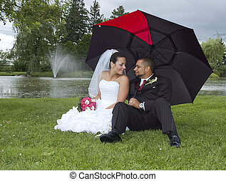Married couple - Just married multi ethnic couple looking at...