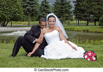 Married couple - Just married multi ethnic couple sitting in...
