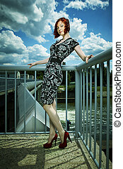 Nice girl on floodgate - Nice redhair lady posing in summer...