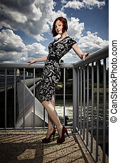 Beauty girl on floodgate - Nice redhair lady posing in...