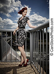 Beautyfull young woman on floodgate - Nice redhair lady...