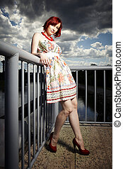 Tiny girl on floodgate - Nice redhair lady posing in summer...