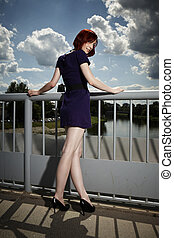Beauty lady posing on floodgate - Nice redhair lady posing...
