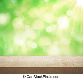 wooden table with garden bokeh, close up