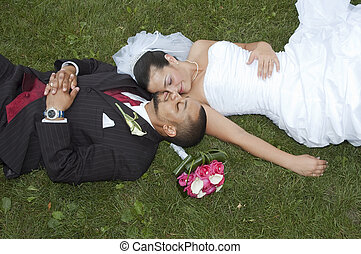 Married couple - Just married multi ethnic couple laying in...