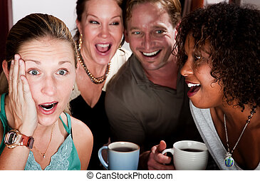 Four Friends Gossiping in a Coffee House - Four adult...