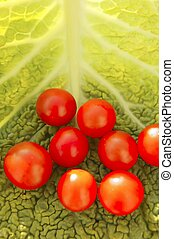 cherry tomatoes and cabbage leaf