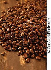 Toasted coffe beans texture under golden light