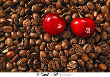 Toasted coffe beans and red cherry - Toasted coffe beans...