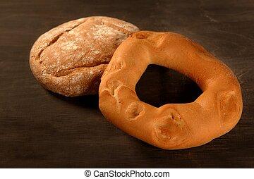 Bread still live over dark wood background