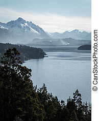 Lake And Misty Snowy Mountain - A forest, mountain and lake...
