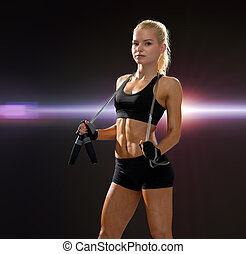 sporty woman with skipping rope - sport, exercise and...