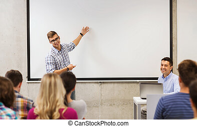 group of students and teacher in classroom - education, high...
