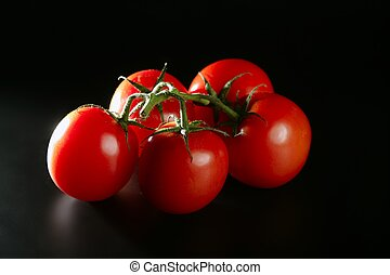 Cluster red tomato over black - Cluster red tomato over dark...