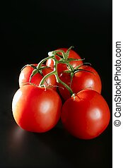 Cluster red tomato over black