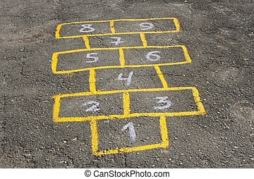 Childish game hopscotch on asphalt - Figures in childish...