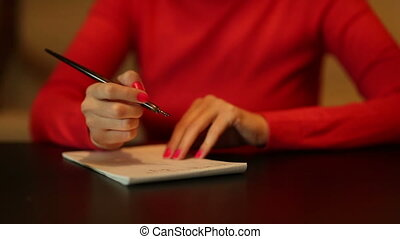 Woman write something Home scene Camera moves before the...
