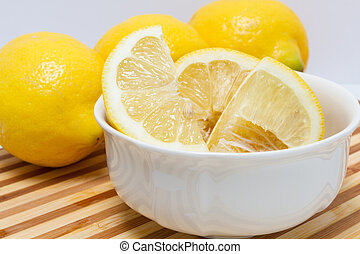 Quartered lemon in white bowl - One quarter
