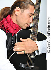 Guitarist - An artist with his guitar on stage show
