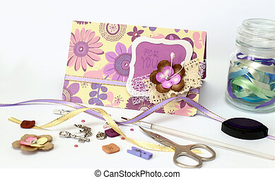 scrapbooking - scrapbook. Card and tools with decoration on...