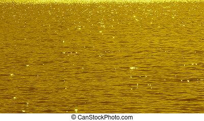 Golden sparkling lake. Slo-mo.