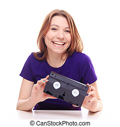 Young girl holding a VHS tape - studio shoot