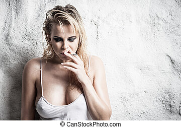 Wet hair - Young lady with wet hair smoking a cigarette...