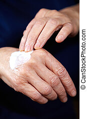 Anti aging cream for hands - Senior woman with anti aging...