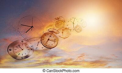 Time flies - Clocks in bright sky. Time flies
