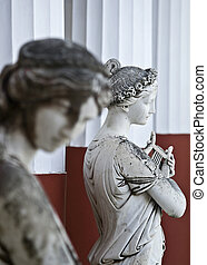 Ancient alike women goddess Greek statue standing at...
