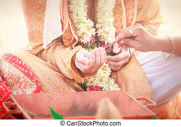 newlywed hands with mehendi and bracelets