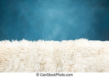 white fur carpet and blue painted wall , use for background