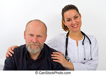 Home care - Elderly man with his caregiver at home