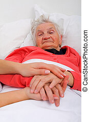 Elderly care - Elderly woman with her caregiver at home
