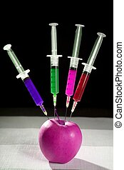 apple manipulation with syringes - Bio genetics research of...