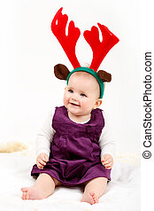 Child girl with reindeer antlers