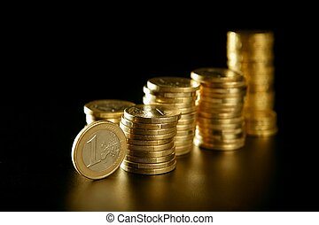 Euro currency coin columns with golden reflections
