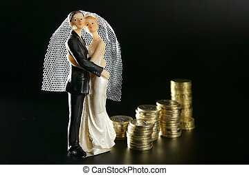 wedding couple figurine and golden coins - Love and money...